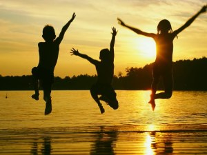 kids-jumping-off-of-dock